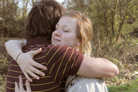 Couple hugging in park Stock Photo