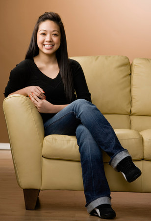 Smiling girl sitting on couch