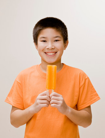Boy holding a popsicle Stock Photo