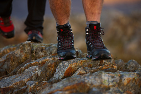 Close up of hiking boots on mountainside Stock Photo