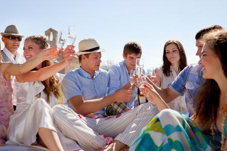 Friends toasting newlywed couple