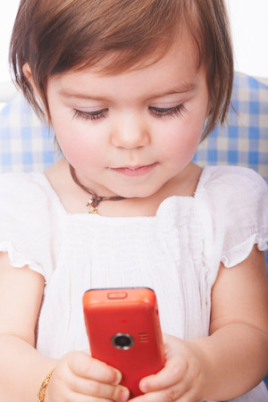 Baby girl playing with cell phone