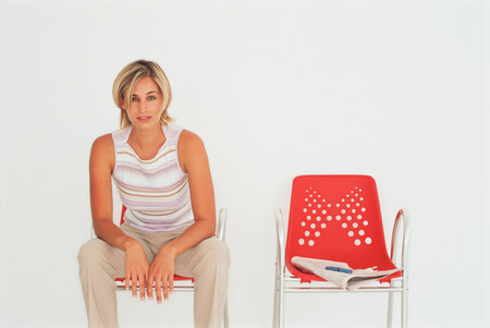 Businesswoman sitting in modern chair