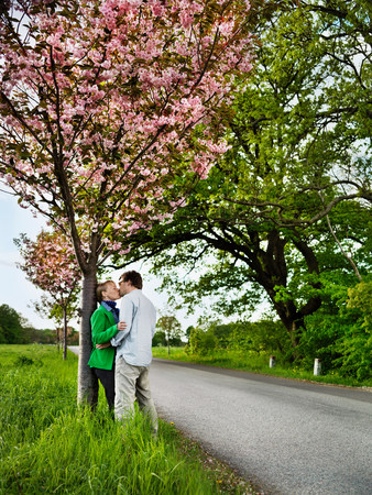 Couple kissing on rural road