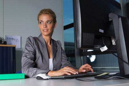 Businesswoman working at desk Reklamní fotografie