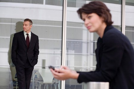 Businessman leaning on glass wall Stock Photo