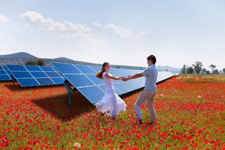 Couple playing by solar panels