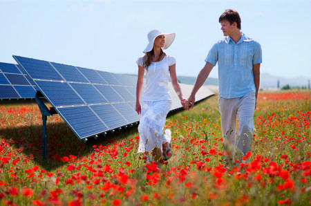 Couple walking by solar panels