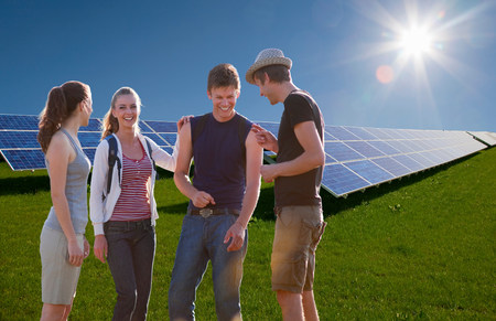 People talking by solar panels