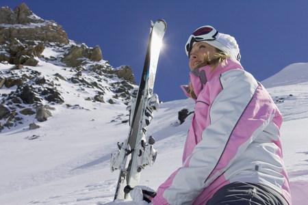 Skier resting on mountainside