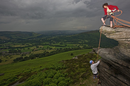 Rock climbers scaling steep rock face