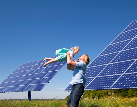 Father and daughter by solar panels Stok Fotoğraf