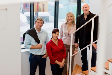 Business people standing on steps Stock Photo