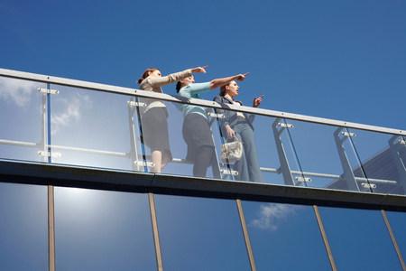 Businesswomen talking on walkway
