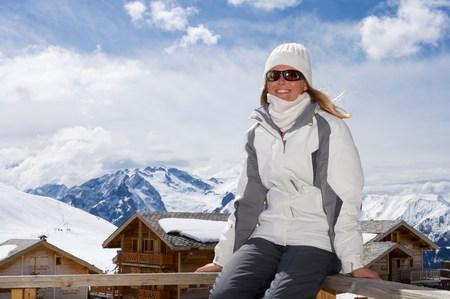 Woman relaxing on ski lodge balcony