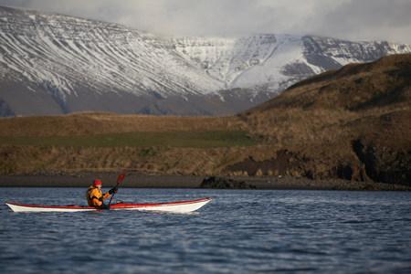 Man rowing canoe in lake Stock Photo