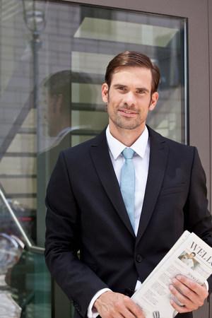 Businessman with newspaper outdoors Reklamní fotografie
