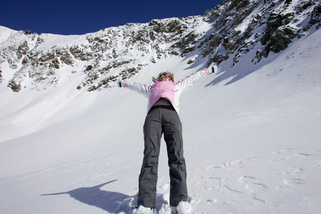 Woman skiing backwards down slope