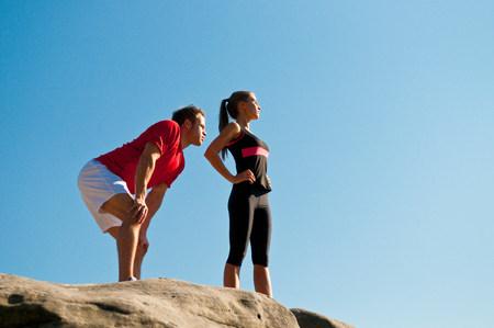 Rock climbers standing on boulder 版權商用圖片
