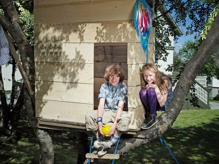 Children playing in treehouse