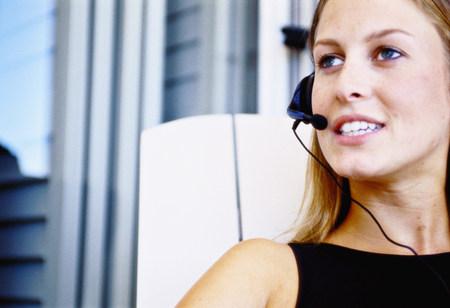 Businesswoman talking on headset Foto de archivo