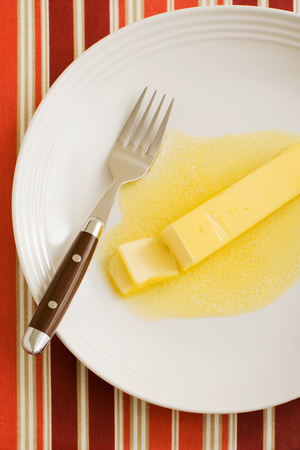 Butter melting on a plate