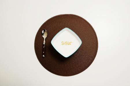 Bowl of sugar and spoon