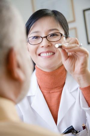 A doctor examining a patient Banco de Imagens