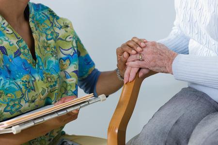 A nurse consoling a patient