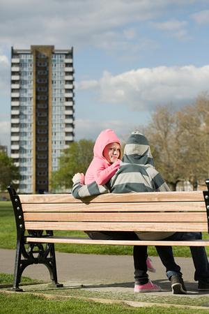 Teenage couple in hoodies