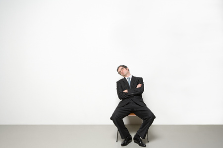 Businessman sleeping in chair Banque d'images