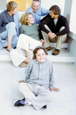 Boy with parents and grandparents Stock Photo