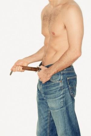 Man adjusting his belt Stock Photo