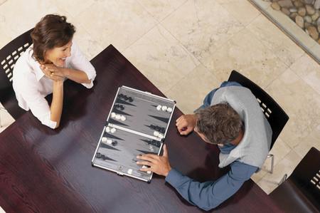 Man and woman playing backgammon