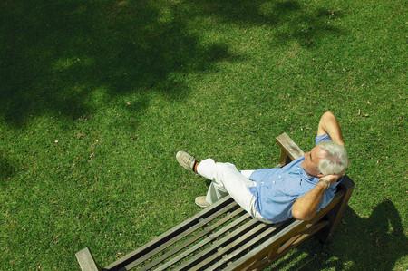 Man sitting on bench 写真素材