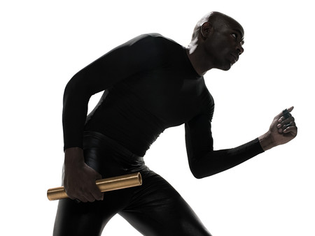 Young man holding a relay baton Stockfoto