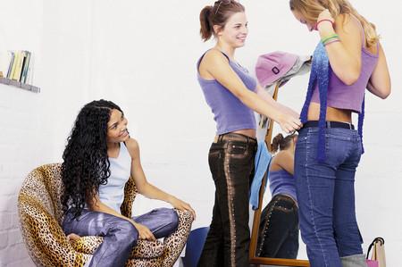 Teenage girls dressing Stock Photo