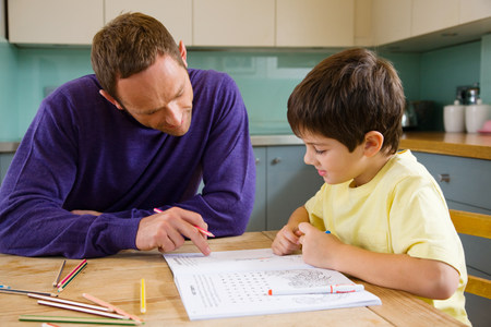 Father helping his son with his homework Stockfoto