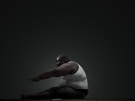 Overweight man doing sit up