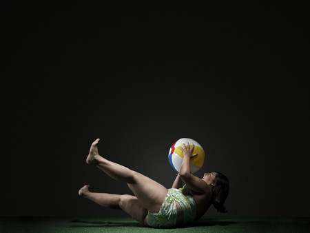 Girl catching beach ball Stok Fotoğraf