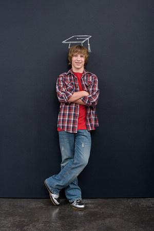 A boy with a chalk mortar board