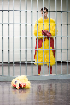 Prisoner in chicken suit Фото со стока
