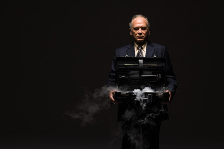 Businessman with smoking briefcase Foto de archivo