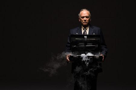 Businessman with smoking briefcase 写真素材