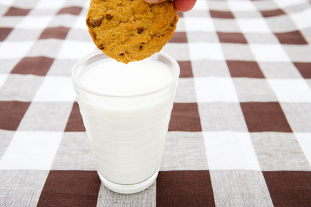 A cookie and milk background.
