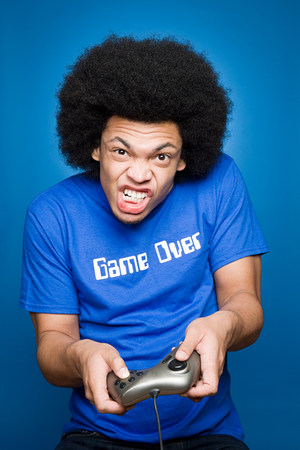 A young man playing a video game