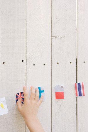 Childs hand and flags Banco de Imagens