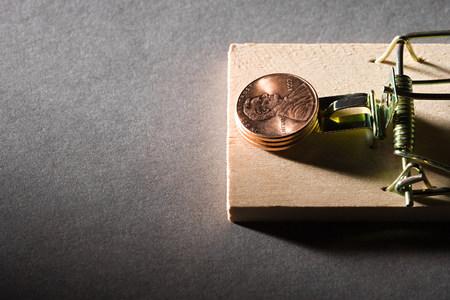 Coins on mousetrap Stok Fotoğraf