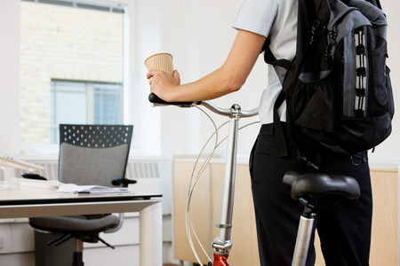 Person in office with bike Stock Photo