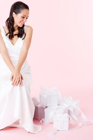 Bride looking at wedding gifts 免版税图像